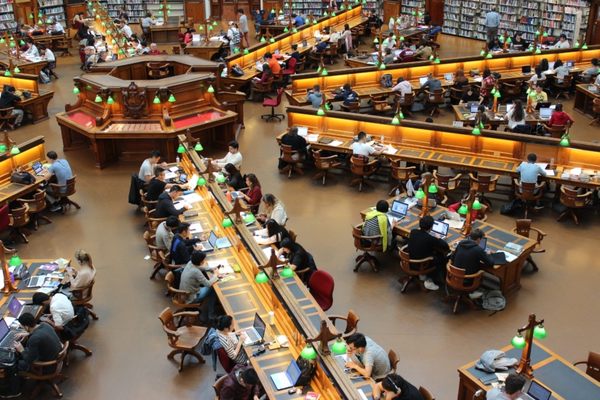 Many students studying at a college library