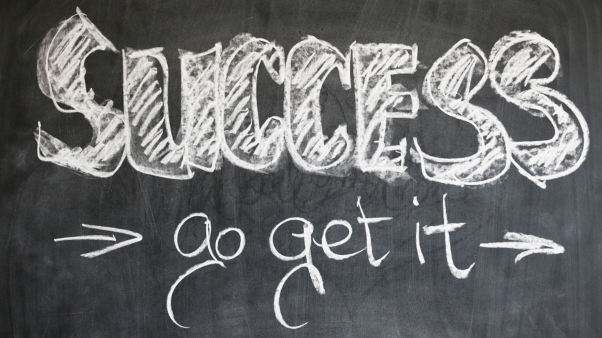 Blackboard with message about success