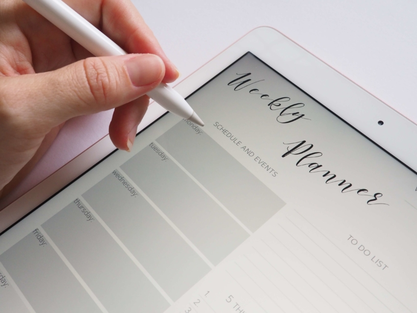 Student filling out weekly planner