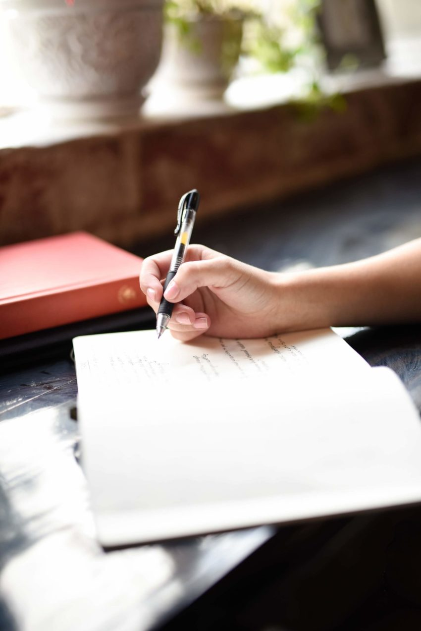 Person writing in a journal