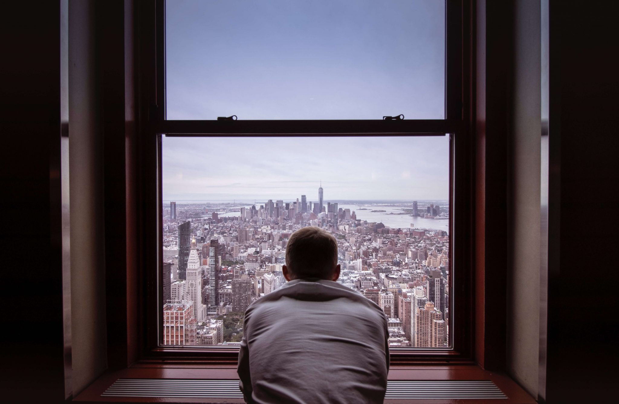 University of the People student reflecting from NYC window