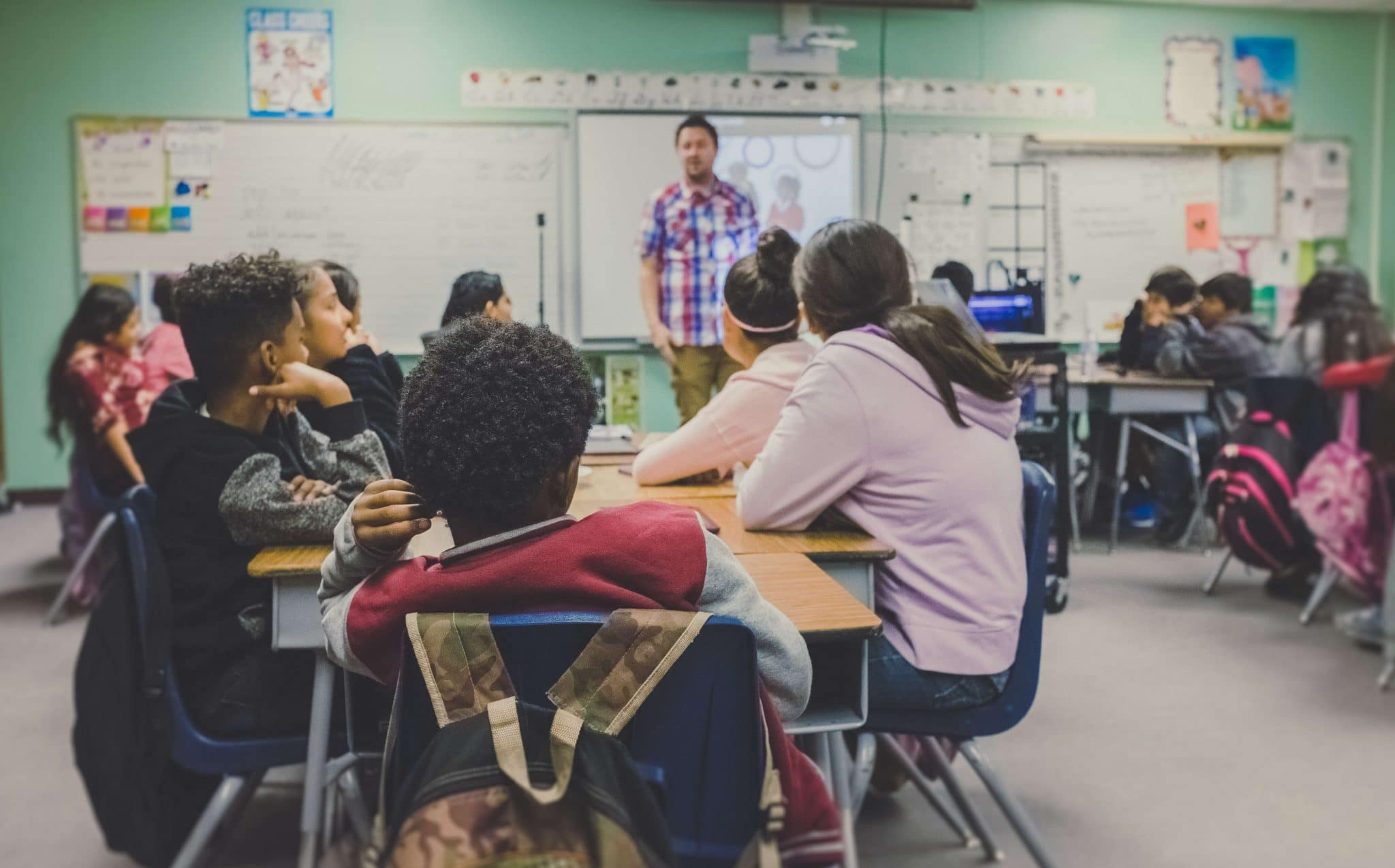 Teaching social studies to students in classroom