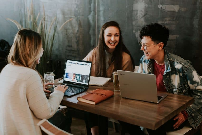 Online social work degree students together at table