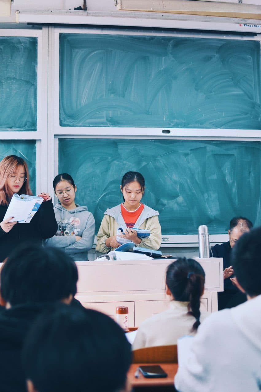 Students in front of a classroom presenting