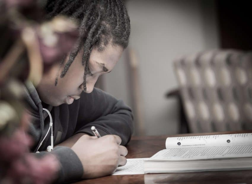 Student taking a test with an open-book