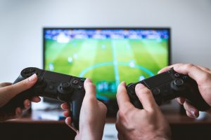 two gamers with controllers testing a game